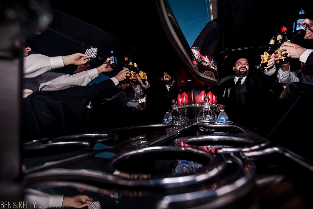 limo - groom - wedding party - toast - benandkellyphotography