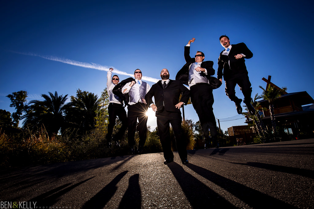 jumping photo - groom - best man - wedding party portraits - phoenix zoo - weddings - wedding - weddings at the phoenix zoo - phoenix zoo wedding - benandkellyphotography
