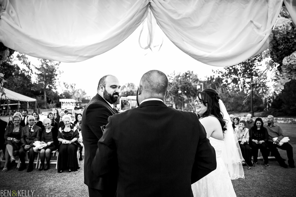 bride and groom saying their vows - vows - wedding vows - wedding ceremony - wedding ceremony at the phoenix zoo - ceremony - phoenix zoo - weddings - wedding - weddings at the phoenix zoo - phoenix zoo wedding - benandkellyphotography