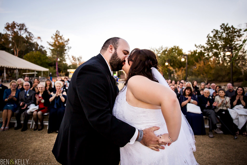 first kiss - the first kiss - bride and groom - bride - groom - wedding ceremony - wedding ceremony at the phoenix zoo - ceremony - phoenix zoo - weddings - wedding - weddings at the phoenix zoo - phoenix zoo wedding - benandkellyphotography