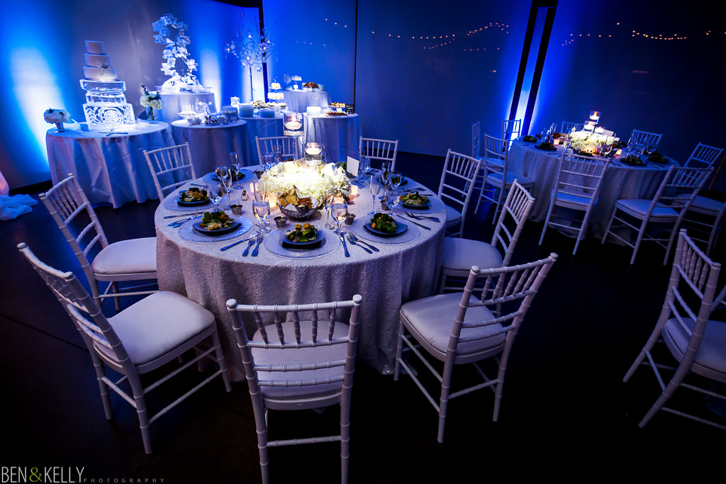 table setting at the phoenix zoo - table setting - wedding reception at the phoenix zoo - wedding reception - winter - winter wonderland - candles - flowers - phoenix zoo - weddings - wedding - weddings at the phoenix zoo - phoenix zoo wedding - benandkellyphotography