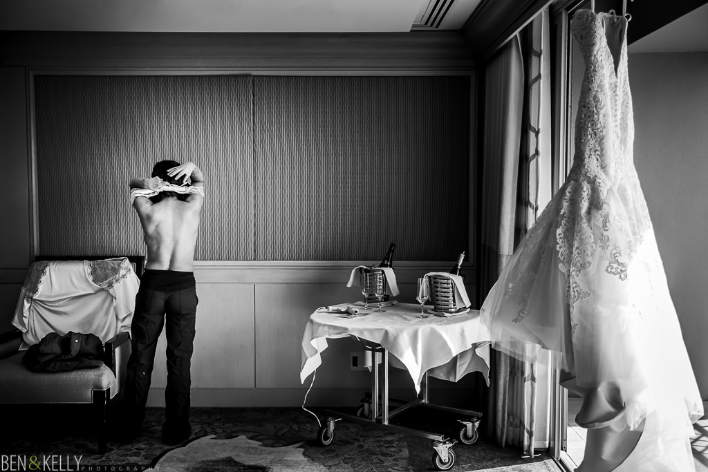 bride getting dressed at the phoenician - benandkellyphotography