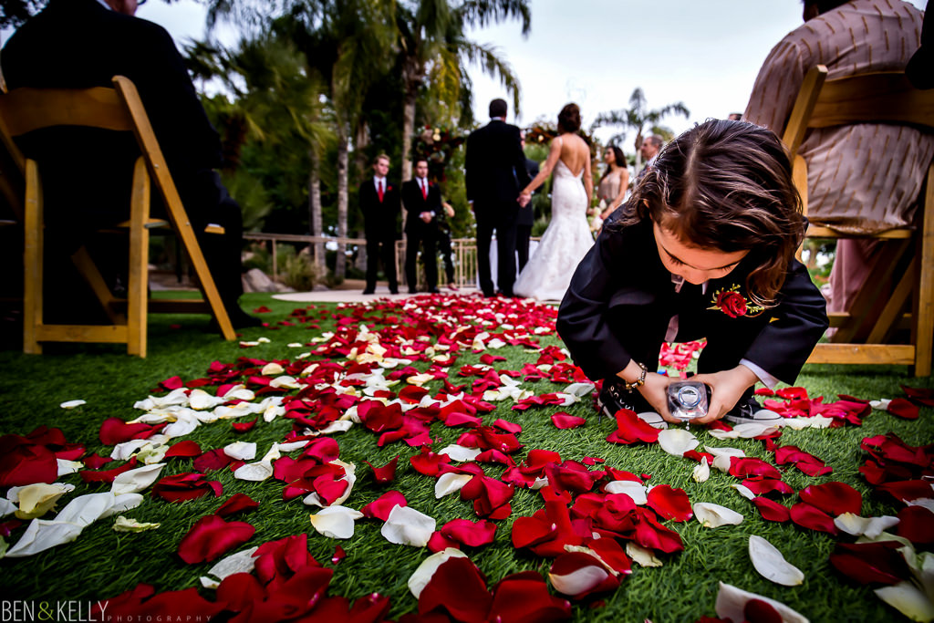 running ring bearer watering petals at the phoenician - wedding at the phoenician - benandkellyphotography