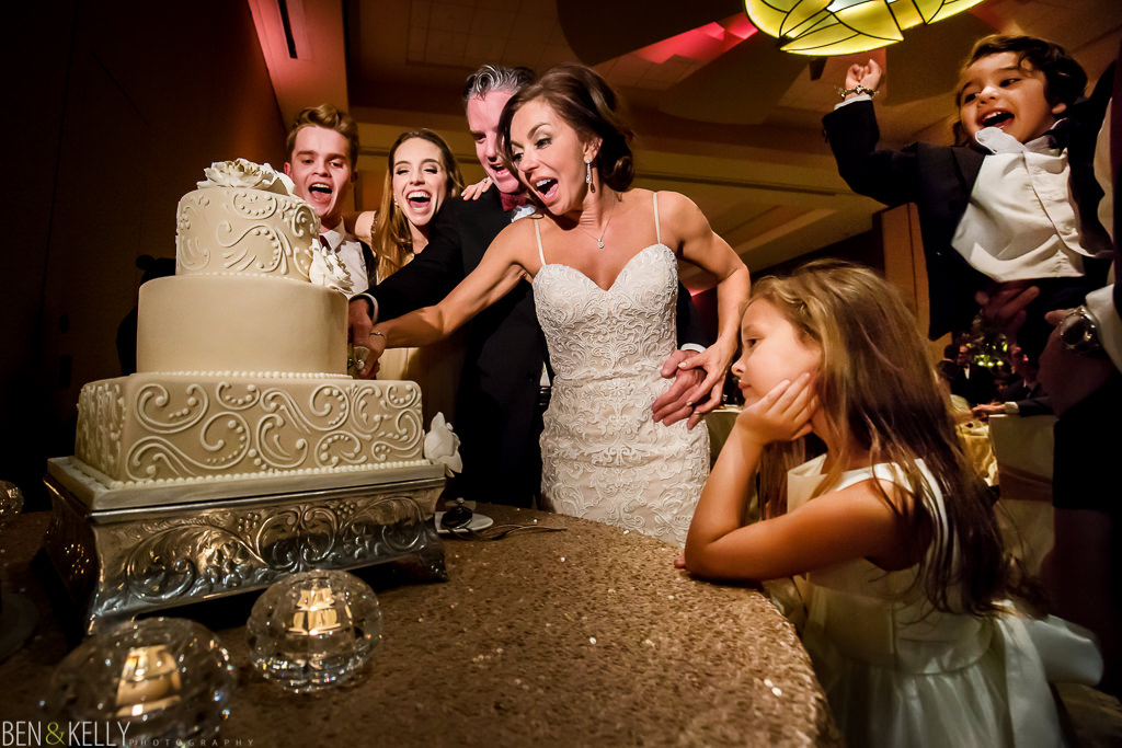 wedding cake cutting at the phoenician - wedding reception at the phoenician - benandkellyphotography