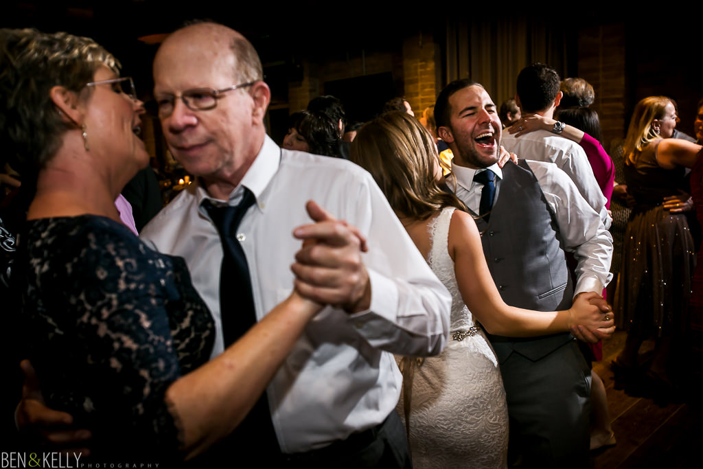 happy dancing - wedding - Ben and Kelly Photography