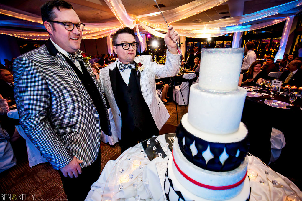 cake cutting - grooms cake - ben and kelly photography