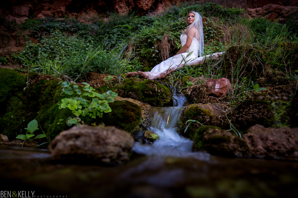 Bride in stream at Havasu Falls - Ben and Kelly Photography